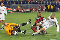 MatroStars' goal keeper Tim Howard stops a point blank shot by Steve Morrow in the 90th minute as Eddie Pope defends. The Dallas Burn were defeated by the NY/NJ MetroStars 2-1 on 5/24/03 at Giant's Stadium, East Rutherford, NJ.