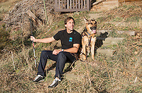 Blind Adventurer and Motivational Speaker Erik Weihenmayer (cq) and his service dog near his home in Golden, Colorado on Wednesday, December 18, 2013. Despite losing his vision at the age of 13, Erik Weihenmayer has become one of the most accomplished adventurers in the world. Weihenmayer is the only blind person who has reached the summit of Mount Everest and the tallest peak on each continent.<br /> <br /> Photo by Matt Nager