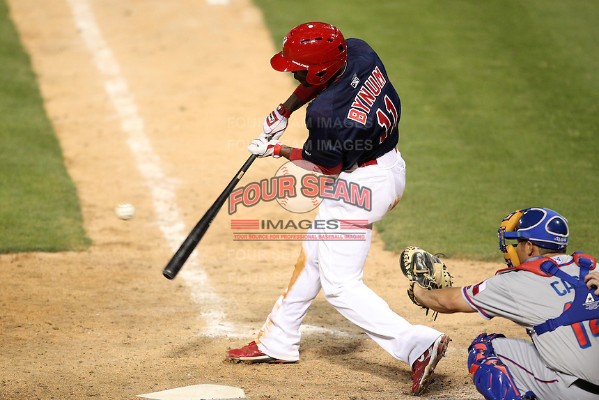 Memphis Redbirds second baseman Freddie Bynum #11 at bat during a game versus the Round Rock Express at Autozone Park on April 28, 2011 in Memphis, Tennessee.  Memphis defeated Round Rock by the score of 6-5 in ten innings; catcher is Kevin Cash in lower right.  Photo By Mike Janes/Four Seam Images