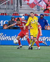 2 May 2009: Columbus Crew midfielder/forward Eddie Gaven #12 and Toronto FC forward Pablo Vitti #8 in action at BMO Field in Toronto in a  game between the Columbus Crew and Toronto FC..The game ended in a 1-1 draw.