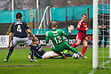 Aberdeen's Niall McGinn crosses the ball before Dundee's Thomas Konrad knocks the ball into his own net.