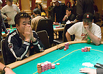 Mack Lee, at left, is all in vs. Mike Matusow, at right.  Lee won and eliminated Matusow.
