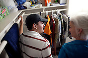 Matthew Rydell of San Antonio, Texas shows Heloise how he organizes his closet in his dorm room on the campus of Texas State University in San Marcos. Matthew lives in the dorm room that Heloise lived in forty years previous. Heloise offered Matthew a host of housekeeping tips. July 14, 2009.