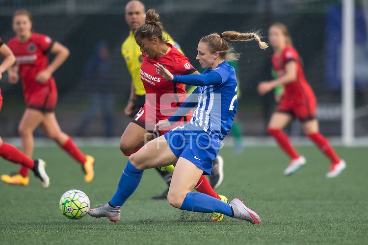 Alston, Massachusetts - May 1, 2016:  The Portland Thorns (red and black)  beat the Boston Breakers  (blue) 1-0 in a National Womens Soccer League (MWSL) match at Jordan Field.