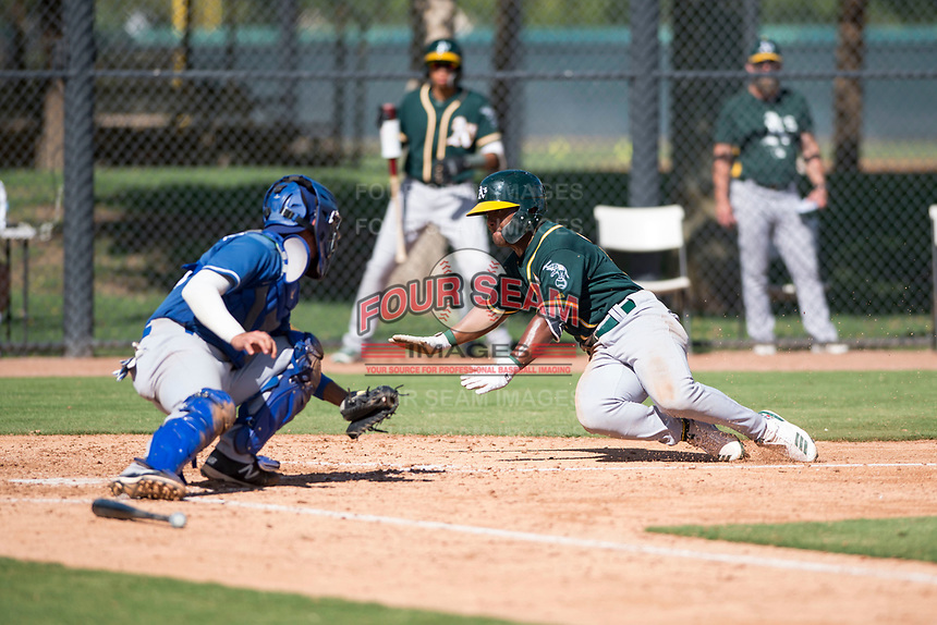 Oakland Athletics second baseman Cobie Vance (19) attempts to avoid the tag from Marco Hernandez (96) during an Instructional League game against the Los Angeles Dodgers at Camelback Ranch on October 4, 2018 in Glendale, Arizona. (Zachary Lucy/Four Seam Images)