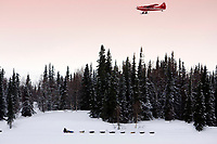 An Otter airplane from K2 aviation flies over Gene Smith on Finger Lake just prior to the Finger Lake checkpoint.
