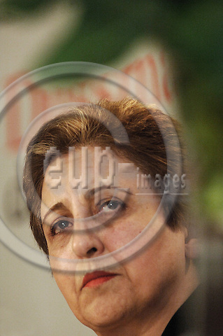 """BERLIN - GERMANY 19. APRIL 2006 -- 2003 Nobel Peace Prize winner Shirin Ebadi of Iran holds her soon to be released autobiography """"Mein Iran"""" (English title: Iran Awakening) during a press conference in Berlin 19 April 2006. Ebadi, a lawyer and human rights activist, was to become Iran's first ever female judge.. -- PHOTO: GORM K. GAARE / EUP- IMAGES ..This image is delivered according to terms set out in """"Terms for Delivery of Photography & Text"""". (Please see www.fotofactory.dk for more details)."""