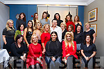 Rebecca Short, front centre with her family and friends  presenting a beautiful and favourites make up and skin care demo in Benners Hotel for Little Womens Christmas on Saturday night last.