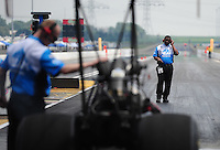 Jul, 10, 2011; Joliet, IL, USA: NHRA top fuel dragster crew members for driver T.J. Zizzo during the Route 66 Nationals at Route 66 Raceway. Mandatory Credit: Mark J. Rebilas-