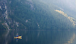 A woman is seen kayaking in at the end of Princess Louisa inlet along the coast of British Columbia.