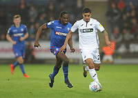 Swansea City's Kyle Naughton under pressure from Bolton Wanderers' Clayton Donaldson<br /> <br /> Photographer Kevin Barnes/CameraSport<br /> <br /> The EFL Sky Bet Championship - Swansea City v Bolton Wanderers - Saturday 2nd March 2019 - Liberty Stadium - Swansea<br /> <br /> World Copyright © 2019 CameraSport. All rights reserved. 43 Linden Ave. Countesthorpe. Leicester. England. LE8 5PG - Tel: +44 (0) 116 277 4147 - admin@camerasport.com - www.camerasport.com
