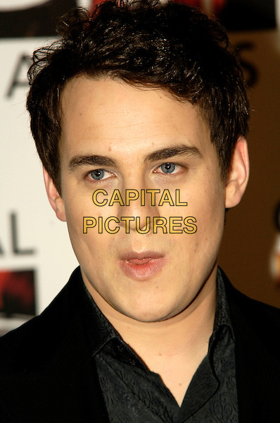 JACK LIEBECK .Attends the 2010 Classical Brit Awards .nomination launch.held at The Mayfair Hotel  in London, England, UK, 12th April 2010..portrait headshot black grey gray mouth open funny .CAP/CJ.©Chris Joseph/Capital Pictures.