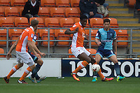 Joe Jacobson of Wycombe Wanderers battles with Armand Gnanduillet of Blackpool during the Sky Bet League 2 match between Blackpool and Wycombe Wanderers at Bloomfield Road, Blackpool, England on 20 August 2016. Photo by James Williamson / PRiME Media Images.