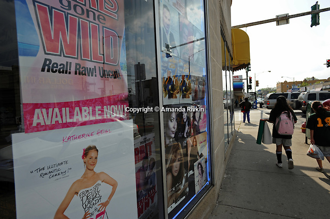 Movie posters feature Western videos like Girls Gone Wild and a film starring Katherine Heigl beside films starring Middle Eastern actresses on the window of a West Devon Avenue shop in Chicago, Illinois on May 5, 2008.  Indian, Pakistani, Muslim and Jewish, Devon Avenue in the West Rogers Park neighborhood is an eclectic representation of the world.