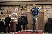 United States President Barack Obama and first lady Michelle Obama make their annual trip to greet current and retired members of the U.S. military and their families as they eat a Christmas Day meal in the Anderson Hall mess hall at Marine Corps Base Hawaii at Kaneohe Bay in Kaneohe Bay, Hawaii, USA, on 25 December 2013.<br /> Credit: Kent Nishimura / Pool via CNP