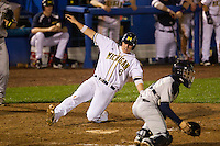Michigan Wolverines third baseman John Lorenz #6 slides into home as catcher Elvin Soto #7 gets a throw during a game against the Pittsburgh Panthers at the Big Ten/Big East Challenge at Florida Auto Exchange Stadium on February 18, 2012 in Dunedin, Florida.  (Mike Janes/Four Seam Images)