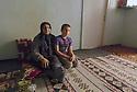 Turkey 2015 <br />Grand- mother with her grand-son in Dogubayazit  <br />Turquie 2015   <br />Une grand-mere et son petit-fils dans leur maison de Dogubayazit