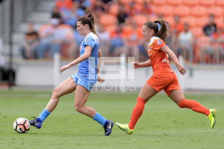 Houston, TX - Saturday April 15, 2017: Stephanie McCaffrey passes the ball in front of Andressa during a regular season National Women's Soccer League (NWSL) match between the Houston Dash and the Chicago Red Stars at BBVA Compass Stadium.