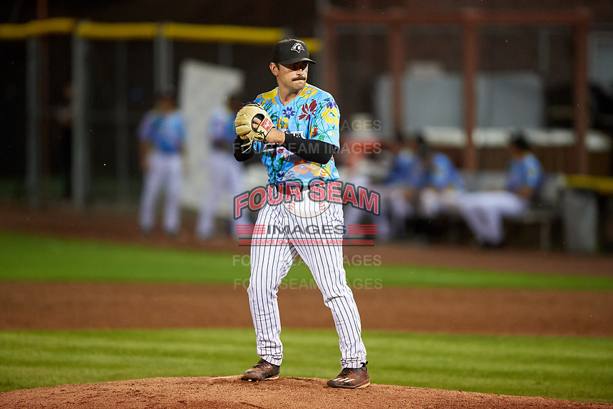 Idaho Falls Chukars relief pitcher Brady Cox (7) prepares to deliver a pitch during a Pioneer League game against the Missoula Osprey at Melaleuca Field on August 20, 2019 in Idaho Falls, Idaho. Idaho Falls defeated Missoula 6-3. (Zachary Lucy/Four Seam Images)