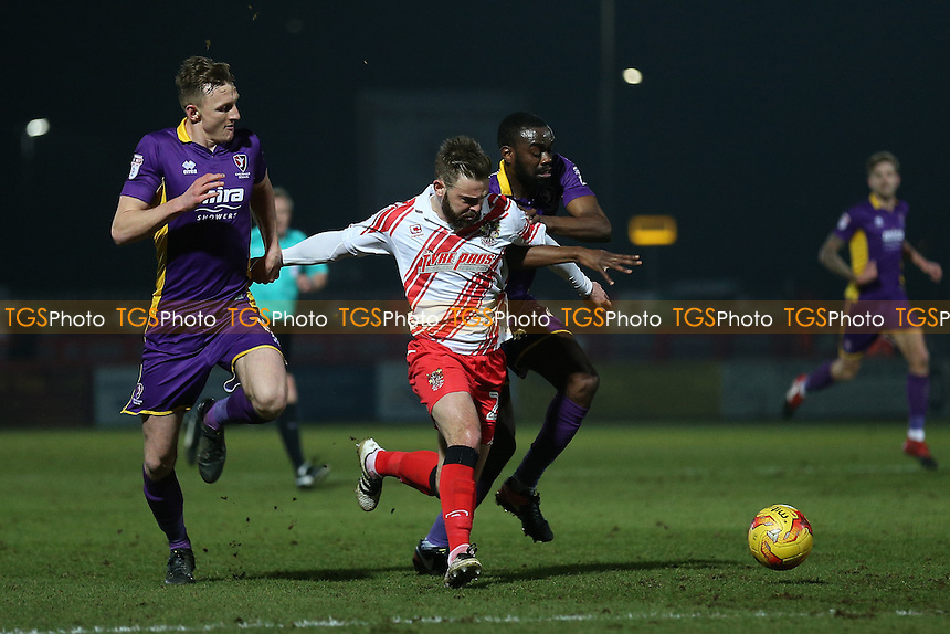 Matthew Godden of Stevenage is brought down by Emmanuel Onariase of Cheltenham Town and a penalty is awarded during Stevenage vs Cheltenham Town, Sky Bet EFL League 2 Football at the Lamex Stadium on 14th February 2017