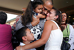 Trooper Paul Acosta, who had just graduated from the North Carolina State Highway Patrol's 125th Basic Patrol School, embraces his family, from left, son Brandon, 7, daughter Daniella, 4, and wife ilene.