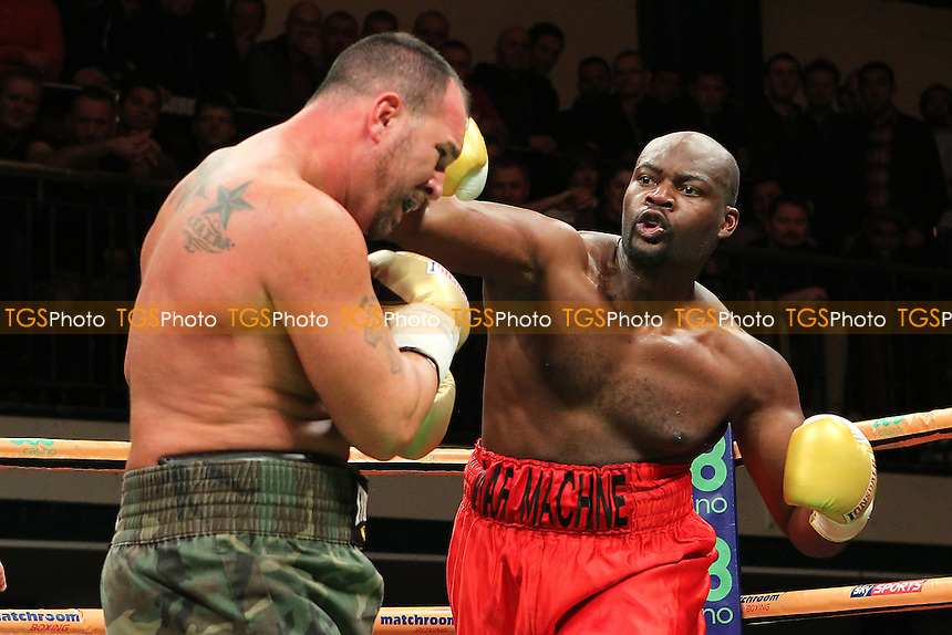 Jason Gavern of the USA defeats Larry Olubamiwo of the UK - UK vs USA Prizefighter International Heavyweight Boxing at York Hall, Bethnal Green, London - 14/11/13 - MANDATORY CREDIT: Gavin Ellis/TGSPHOTO - Self billing applies where appropriate - 0845 094 6026 - contact@tgsphoto.co.uk - NO UNPAID USE