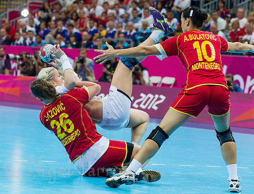 11 AUG 2012 - LONDON, GBR - Heidi Løke (NOR) (top left) of Norway  is stopped by Suzana Lazovic (MNE) (bottom left) of Montenegro during the women's London 2012 Olympic Games handball final at the Basketball Arena in the Olympic Park, in Stratford, London, Great Britain (PHOTO (C) 2012 NIGEL FARROW)