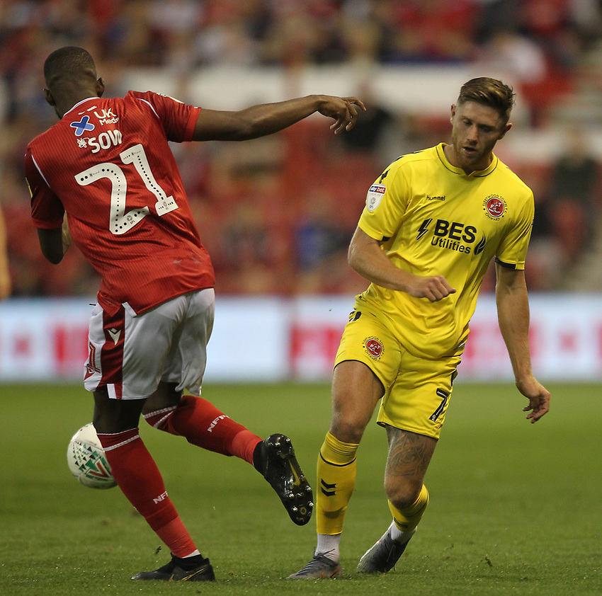 Fleetwood Town's Wes Burns  battles with Nottingham Forest's Samba Sow<br /> <br /> Photographer Mick Walker/CameraSport<br /> <br /> The Carabao Cup First Round - Nottingham Forest v Fleetwood Town - Tuesday 13th August 2019 - The City Ground - Nottingham<br />  <br /> World Copyright © 2019 CameraSport. All rights reserved. 43 Linden Ave. Countesthorpe. Leicester. England. LE8 5PG - Tel: +44 (0) 116 277 4147 - admin@camerasport.com - www.camerasport.com