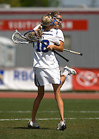 Virginia Crotty (22) of Duke celebrates her goal with teammate (18) Lindsay Gilbride during the first round of the ACC Women's Lacrosse Championship in College Park, MD.  Duke defeated Boston College, 17-6.