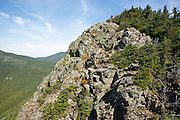 A hiker on the rocky summit of Mount Flume in the White Mountains, New Hampshire USA during the summer months.