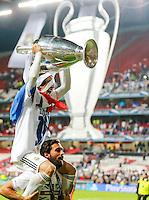 LISBOA, PORTUGUAL, 24.05.2014 - LIGA DOS CAMPEOES - REAL MADRID - ATLETICO DE MADRID - Luka Modric do Real Madrid comemora a conquista da Liga dos Campeões após a vitória por 4 a 1, na prorrogação contra o Atlético de Madrid, no estádio da Luz, em Lisboa, Portugal, neste sábado. O Real conquistou a taça da Liga pela 10ª vez. (PHOTO: PIXATHLON / BRAZIL PHOTO PRESS).