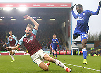 Burnley's Charlie Taylor goes down in the penalty area under the challenge from Leicester City's Wilfred Ndidi<br /> <br /> Photographer Rich Linley/CameraSport<br /> <br /> The Premier League - Burnley v Leicester City - Saturday 16th March 2019 - Turf Moor - Burnley<br /> <br /> World Copyright © 2019 CameraSport. All rights reserved. 43 Linden Ave. Countesthorpe. Leicester. England. LE8 5PG - Tel: +44 (0) 116 277 4147 - admin@camerasport.com - www.camerasport.com