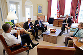 United States President Barack Obama meets with Solicitor General Donald Verrilli, left, and Attorney General Eric Holder in the Oval Office, February 21, 2013. Chief of Staff Denis McDonough and Kathryn Ruemmler, Counsel to the President, join them. .Mandatory Credit: Pete Souza - White House via CNP