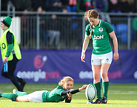 9nd February 2020; Energia Park, Dublin, Leinster, Ireland; International Womens Rugby, Six Nations, Ireland versus Wales; Kathryn Dane (Ireland) holds the ball steady in the high winds as Claire Keohane (Ireland) sets up the conversion