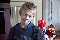 Polish boy age 10 showing his new timer in the shape of a plastic red pepper. Zawady Central Poland