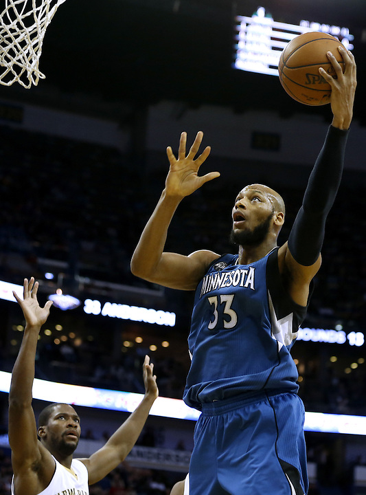 Minnesota Timberwolves forward Adreian Payne (33) shoots over New Orleans Pelicans guard Toney Douglas, left, during the second half of an NBA basketball game Saturday, Feb. 27, 2016, in New Orleans. The Timberwolves won 112-110. (AP Photo/Jonathan Bachman)