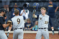 Kyle Gray (9) of the West Virginia Mountaineers is greeted at home plate by teammate Kevin Brophy (23) after hitting a home run against the Wake Forest Demon Deacons in Game Six of the Winston-Salem Regional in the 2017 College World Series at David F. Couch Ballpark on June 4, 2017 in Winston-Salem, North Carolina. The Demon Deacons defeated the Mountaineers 12-8. (Brian Westerholt/Four Seam Images)