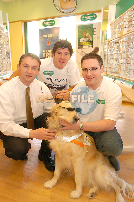 "Irish International Rugby Player Shane Horgan with Guide Dog Bruce helping to launch the Irish Guide Dogs for the Blind ""Shades for a Day"" on May 7th in Specsavers in Drogheda town Centre, With David McCloskey and Keril Hickey from Specsavers..Photo AFP/NEWSFILE/FRAN CAFFREY..(Photo credit should read FRAN CAFFREY/NEWSFILE/AFP)...This Picture has been sent you under the condtions enclosed by:.Newsfile Ltd..the Studio,.Millmount Abbey,.Drogheda,.Co Meath..Ireland..Tel: +353(0)41-9871240.Fax: +353(0)41-9871260.GSM: +353(0)86-2500958.email: pictures@newsfile.ie.www.newsfile.ie.FTP: 193.120.102.198..This picture is from Fran Caffrey@newsfile.ie"
