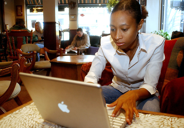 16788Students studying on and off campus: Colby Ware..Atoyia Deans decided to study at one of her favorite coffee shops, Perks.