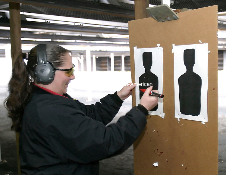 CHESHIRE, CT, 28 MARCH 2006- 032806BZ02-<br /> Range master Jackie Marvel scores a target during training at the firing range at the Connecticut Correctional Institution in Cheshire Tuesday afternoon.<br /> Jamison C. Bazinet Republican-American