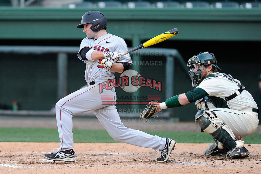 Left fielder Jack Colton (9) of the Harvard Crimson bats in a game against the Michigan State Spartans on Saturday, March 15, 2014, at Fluor Field at the West End in Greenville, South Carolina. The catcher is Joel Fisher (32). Michigan State won, 4-0. (Tom Priddy/Four Seam Images)