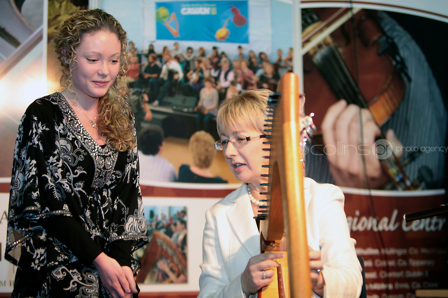 NO FEE PICTURES.28/1/11 Minister Mary Hanafin with Niamh Denamead at the Ceoltas Ceoltorai Eireann stand at the launch of the Holiday World Show at the RDS, Dublin, which runs from Friday 28th untill Sunday 30th January. Picture: Arthur Carron/Collins