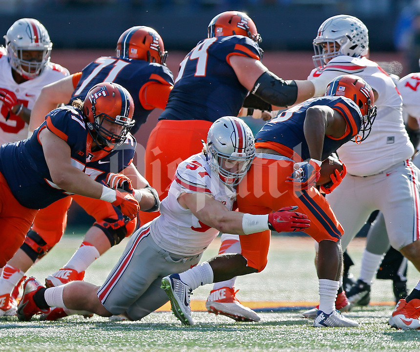 Ohio State Buckeyes defensive lineman Joey Bosa (97) makes a tackle against Illinois Fighting Illini running back Josh Ferguson (6) in the first half at Memorial Stadium in Champaign, IL on November 9, 2015.  (Dispatch photo by Kyle Robertson)