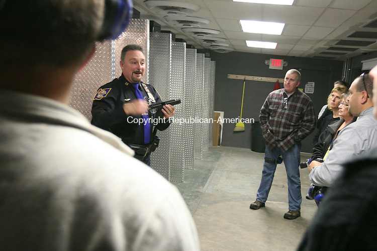 TORRINGTON, CT - 21 October, 2009 - 102009MO10 - Capt. Francis Balzano gives a pre-shooting briefing Tuesday during a citizen's police academy class held at Tactical Arms. In all, 15 local residents are participating in a 10-week program designed to familiarize member of the public with the day-to-day duties and responsibilities of police officers. Jim Moore Republican-American.