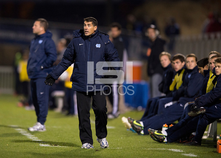 North Carolina head coach Carlos Somoano looks for clarification from a referee on a call during the game at the Maryland SoccerPlex in Germantown, MD. North Carolina defeated Virginia on penalty kicks after playing to a 0-0 tie in regulation time.  With the win the Tarheels advanced to the finals of the ACC men's soccer tournament.