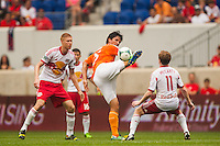 Brian Ching (25) of the Houston Dynamo plays the ball behind his back. The New York Red Bulls defeated the Houston Dynamo 2-0 during a Major League Soccer (MLS) match at Red Bull Arena in Harrison, NJ, on June 30, 2013.