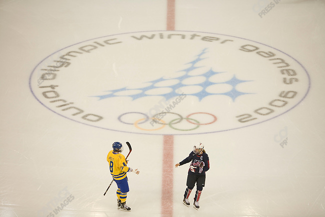Women's hockey USA-SWE medal round at Palasport Olimpico in Turin during the Torino Winter Olympics. SWE wins in double overtime. Captains Erika Holst of SWE and Krissy Wendell of USA shake hands before the game.