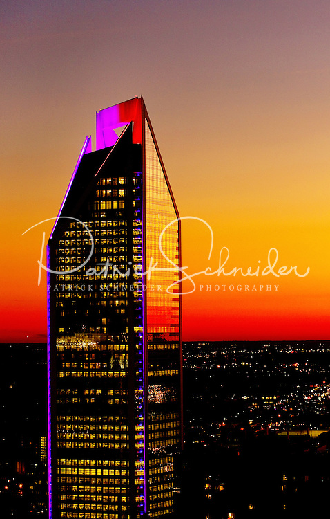 The Duke Energy Tower, Charlotte NC's newest skyscraper, reflects the brilliant glow of the setting sun. The Duke Energy Center is Charlotte's second-tallest building, standing 786 feet tall, but is the city's largest building in terms of square footage. The Duke tower was completed in 2010.