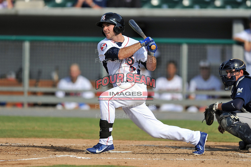 Tennessee Smokies center fielder Matt Szczur #4 swings at a pitch during game one of a double header against the Huntsville Stars at Smokies Park on July 8, 2013 in Kodak, Tennessee. The Stars won the game 2-0. (Tony Farlow/Four Seam Images)