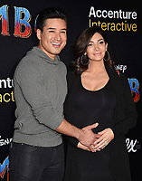 HOLLYWOOD, CA - MARCH 11: Mario Lopez (L) and Courtney Laine Mazza attend the premiere of Disney's 'Dumbo' at El Capitan Theatre on March 11, 2019 in Los Angeles, California.<br /> CAP/ROT/TM<br /> &copy;TM/ROT/Capital Pictures